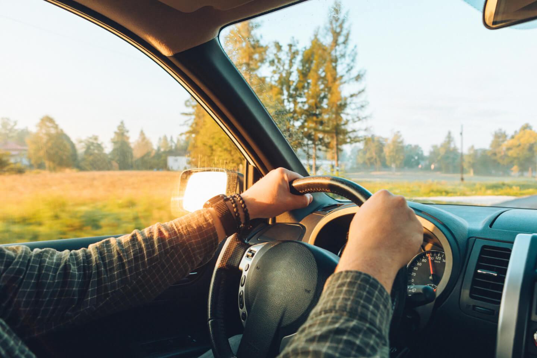 A man driving in a car.